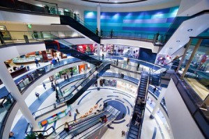 11691239-modern-shopping-mall-interior-busy-sale-time